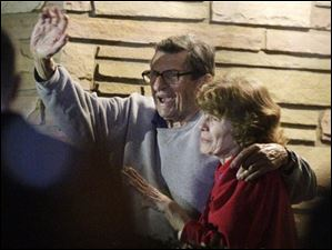 Former Penn State Coach Joe Paterno and his wife, Sue Paterno, stand on their porch to thank supporters gathered outside their home in State College, Pa. Nov. 9, 2011.