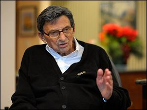 Former Penn State football coach Joe Paterno gestures as while interviewed at his home in State College, Pa. In his first public comments since being fired two months ago, Paterno told The Washington Post he