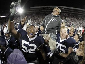 Penn State coach Joe Paterno is carried off the field by his players after getting his 400th collegiate win after their 38-21 victory over Northwestern in an NCAA college football game Nov. 6, 2010, in State College, Pa.