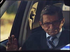 Penn State football coach Joe Paterno arrives home in State College, Pa.
