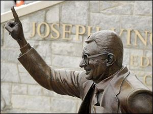 A statue of Joe Paterno stands outside Beaver Stadium on the Penn State University campus.