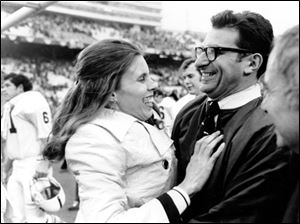 Penn State football coach Joe Paterno is embraced by his wife, Sue, after Penn State's 30-6 victory over Texas in the Cotton Bowl Jan. 1, 1972, in Dallas.
