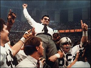 Penn State head football coach Joe Paterno takes a victory ride from his players after defeating Georgia 27-23 in the Sugar Bowl Jan. 1, 1983, at the Supderdome in New Orleans, to win the national championship.