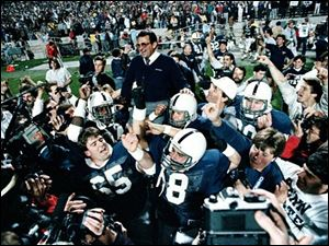 Penn State coach Joe Paterno is carried off after defeating Miami, 14-10, in the Fiesta Bowl Jan. 2, 1987, to win the national championship, in Tempe, Ariz.