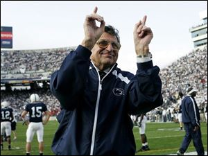 Penn State football coach Joe Paterno acknowledges the crowd during warmups before the game against Wisconsin in 2005 in State College, Pa.