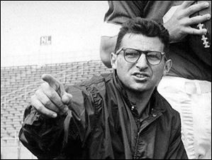 In 1965, Joe Paterno, associate football coach at Penn State, directs players at State College, Pa. Paterno, the longtime Penn State coach who won more games than anyone else in major college football but was fired amid a child sex abuse scandal that scarred his reputation for winning with integrity, died Sunday, Jan. 22, 2012. He was 85.