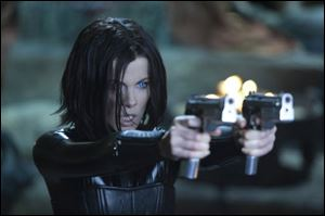 "Kate Beckinsale is shown in a scene from ""Underworld: Awakening."" Beckinsale reprises her role as"