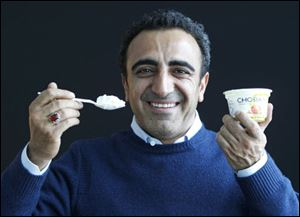 Hamdi Ulukaya, CEO of Chobani Greek Yogurt, poses at the Chobani plant in South Edmeston, N.Y. Greek yogurt now accounts for a quarter of the total yogurt market after a dizzying growth spurt that is especially apparent here in the heart of upstate New York.