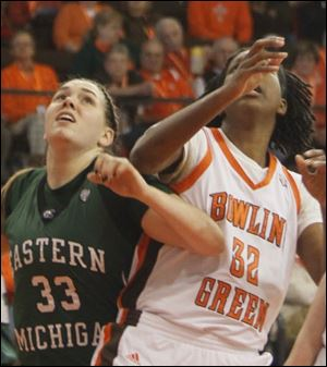 Olivia Fouty, a Northview graduate, battles for position with Alexis Rogers. Fouty finished with four points and two rebounds for Eastern Michigan Sunday afternoon.