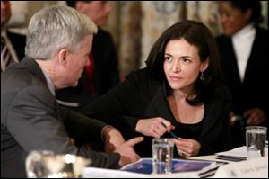 Facebook COO Sheryl Sandberg talks with Mark T. Gallogly, founder and managing partner of Centerbridge Partners, before President Barack Obama hosted a meeting with the Council on Jobs and Competitiveness in the State Dining Room of the White House in Washington in January.
