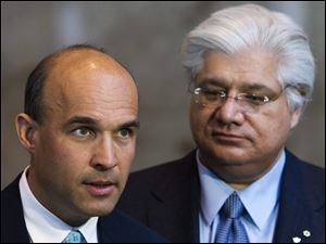 Research In Motion co-CEOs Jim Balsillie, left, and Mike Lazaridis are stepping down, and will be replaced by Thorsten Heins, a chief operating officer who joined RIM four years ago from Siemens AG.