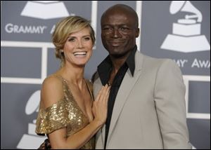 Heidi Klum, left, and Seal arrive at the 53rd annual Grammy Awards in Los Angeles.