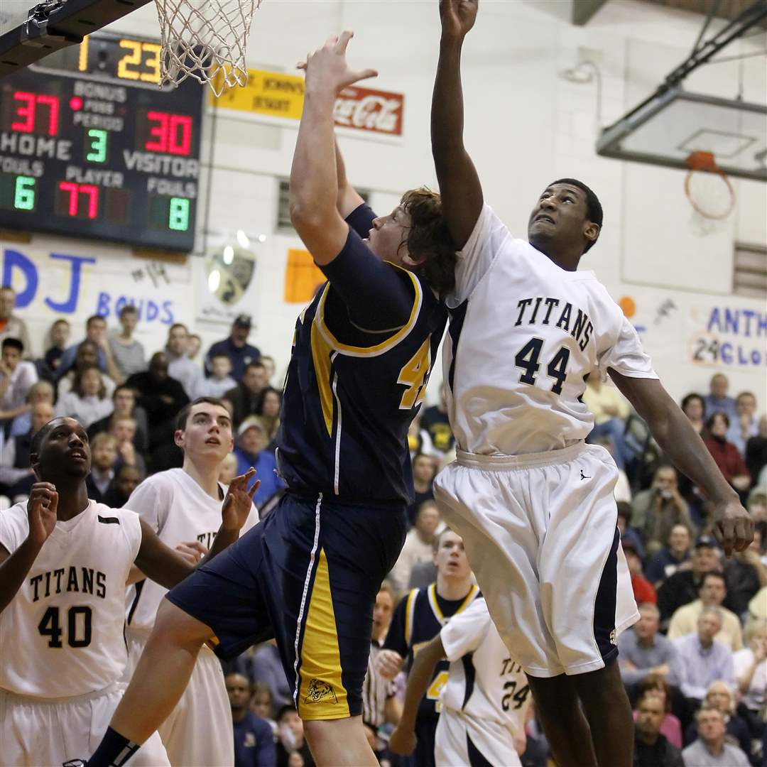 St-John-s-Caleb-Wallace-fights-for-a-rebound-with-Whitmer-s-Storm-Norton