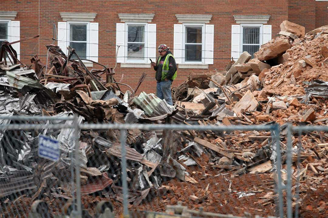 Seneca-Courthouse-rubble-worker