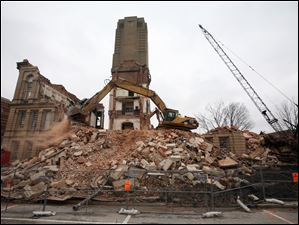 A backhoe continues to make rubble out of the 1884 Seneca County Courthouse.