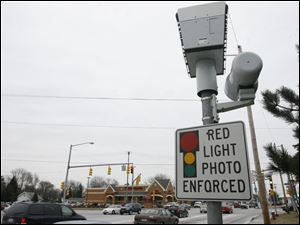 A Red-Light camera on the southbound corner of Secor and Monroe Streets.