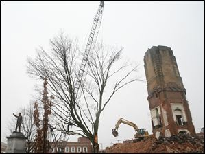 Demolition of Seneca County's 1884 courthouse continues Thursday Jan. 26, 2012, in Tiffin, Ohio.