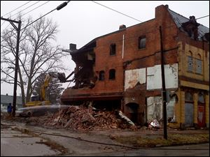 Crews on Thursday begin to demolish the Playdium building in East Toledo.