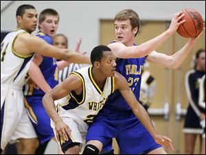 Whitmer's Leroy Alexander (24) defends against Findlay's Adam Twining (23).