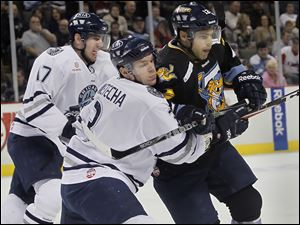 Express player #17, Aaron Marvin, left, and #3 Scott Wietecha pursue Walleye player #12, Aaron Lewicki.