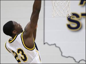Whitmer's Nigel Hayes (23) dunks the ball.