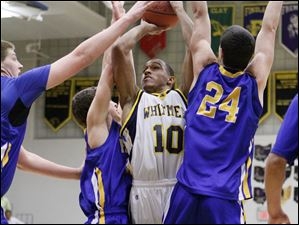 Whitmer's Ricardo Smith(10) goes to the net against Findlay's Joseph Davison (24).