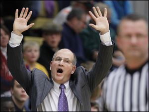 Whitmer head coach Bruce Smith reacts to a foul.
