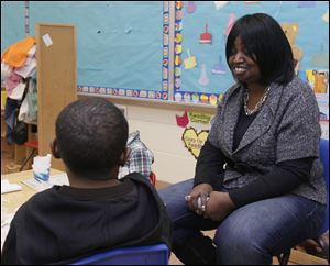 Teacher Joyce Wilson talks with the children about teeth brushing. A Head Start class at Mayfair School in Toledo, Ohio.  N.B.: The school would not allow any of the children's names to be in the paper.