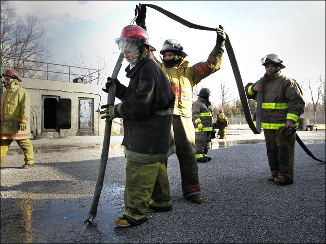 U.S. maritime official stops in Lucas County Toledo Maritime Academy seniors Melaine Hileman, left, Taylor Mundy, and Daryl Winfree take part in a fire-training exercise.