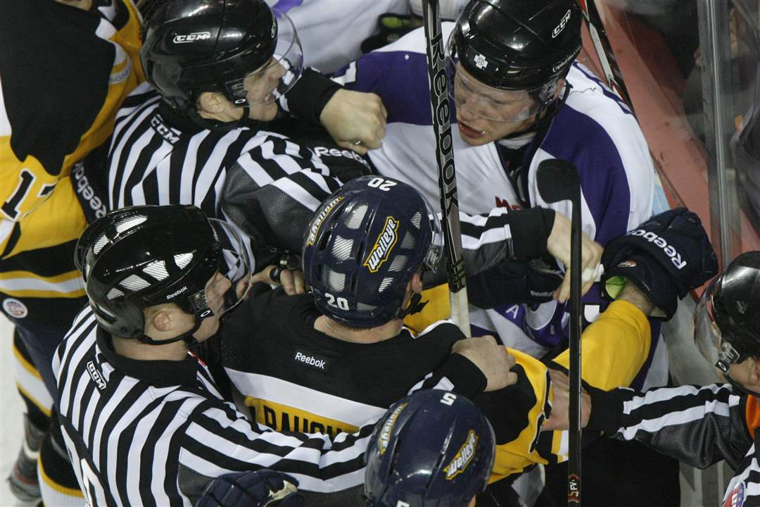 Officials-try-to-separate-Toledo-Walleye-player-Phil-Rauch-and-Reading-s-Olivier-Labelle