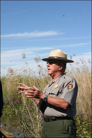 Ranger Kirk Singer explains the threats to the Everglades created by a number of exotic species -- pets that have been released into the park and taken up residence there.