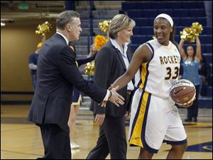 Before the Akron game at Savage Arena, UT athletic director Mike O'Brien and head coach Tricia Cullop present Yolanda Richardson with a commemorative game ball for breaking UT's blocked shot record at Buffalo on Saturday.