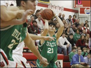 Delta's Scott Garlinger takesa three pointer in the first period of the game against Wauseon on February 3, 2012.