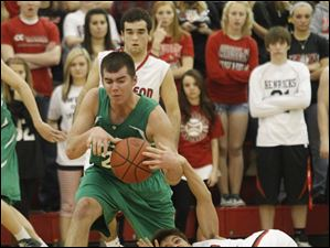 Wauseon's Tre Henricks, right, and  Delta's Blake Green fight for the ball.
