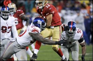 The Giants' Jason Pierre-Paul, left, has combined with fellow ends Osi Umenyiora and Justin Tuck have combined for 30  1/2 sacks this season.