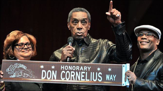 Obit Cornelius Chicago Don Cornelius, center, is presented with an honorary street sign named after him by Commissioner of Cultural Affairs Michelle Boone, left, and 27th Ward Alderman Walter Burnett on Sept. 5, 2011, before the start of the