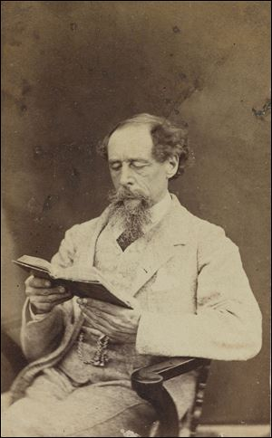 Charles Dickens, shown in 1863, remains best known perhaps for 'A Christmas Carol.' A manuscript signed in December, 1843, is in the Morgan Library in New York. The author 'invented the cliffhanger,' one scholar says.