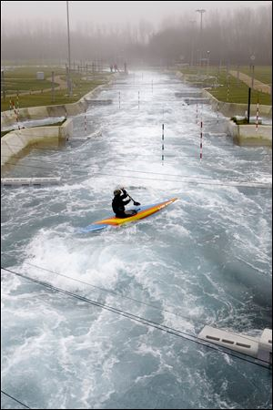 A canoeist paddles down the white water course at the Lee Valley White Water Center in north London. The white water course will host the London 2012 Olympic canoe slalom competitions. The center is open to public for white water rafting until April and after the Olympics.