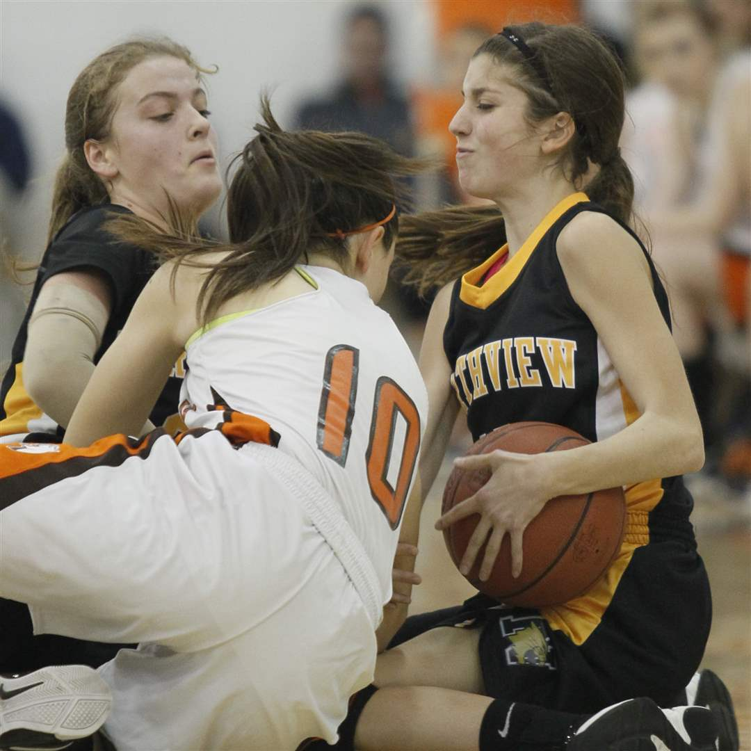 Northview-s-Miriam-Justinger-30-and-Mallory-Small-10-scramble-Southview-s-Bailey-Hejl-10-for-a-loose-ball