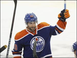 Edmonton Oilers' Sam Gagner salutes the fans after scoring four goals and totalling 8 points against the Chicago Blackhawks during NHL hockey action in Edmonton on Thursday.