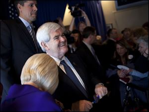 Republican presidential candidate and former House Speaker Newt Gingrich talks with voters Tuesday during a campaign stop at the Price Hill Chili Restaurant in Cincinnati.