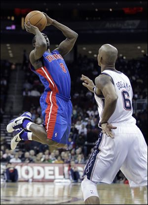 Detroit Pistons' Ben Gordon (8) shoots against New Jersey Nets' Keith Bogans (6) during the second quarter Wednesday night.