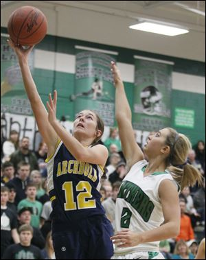 Archbold's Chelsea Goebel (12) goes to the net against  Delta's Bri Raab. Goebel scored 10 points for the 19-0 Blue Streaks.