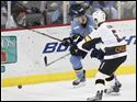 Walleye defender Riley Emmerson and the Cyclones No. 5, Chris Clark battle for the puck as the Walleye host the Cincinnati Cyclones at home in Toledo on Feb. 12.