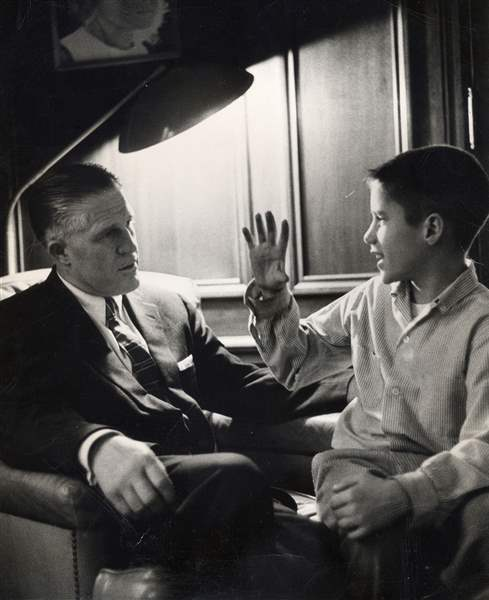 A-young-Mitt-Romney-talks-with-his-father