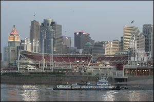Great American Ballpark, home of the Cincinnati Reds, shines in front of the downtown skyline along the Ohio River. With 2.1 million residents, Cincinnati has Ohio's largest metro area.
