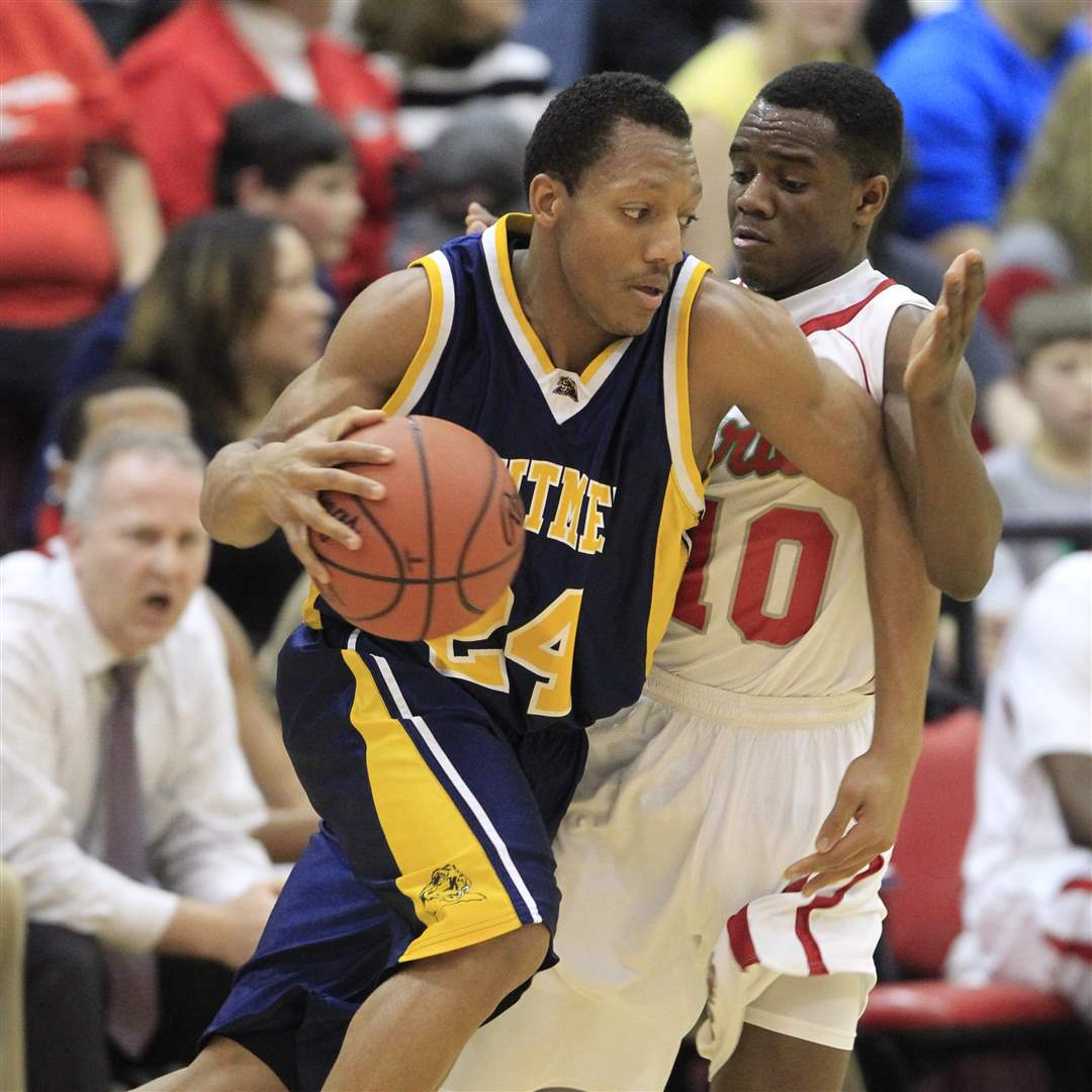 Central-Catholic-Dexter-Johnson-guards-Whitmer-Leroy-Alexander-Friday