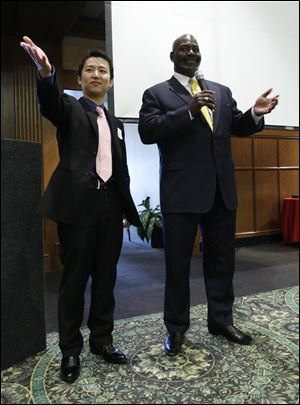 Dashing Pacific Group representative Jimmy Wu and Mayor Mike Bell speak at the Toledo Club in October, 2011. Mr. Wu, the son of investor Wu Kin Hung, has purchased a home in Perrysburg.