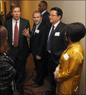 Gov. John Kasich, left, met in March with two figures involved in helping Mayor Bell make connections in China: Scott Prephan, center, and Simon Guo, second from right. Investor Yuan Xiaohong is at right.