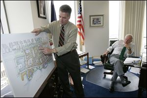 With Mayor Carty Finkbeiner looking on in his Government Center office in June, 2008, developer Larry Dillin goes over his plans for the Marina District.